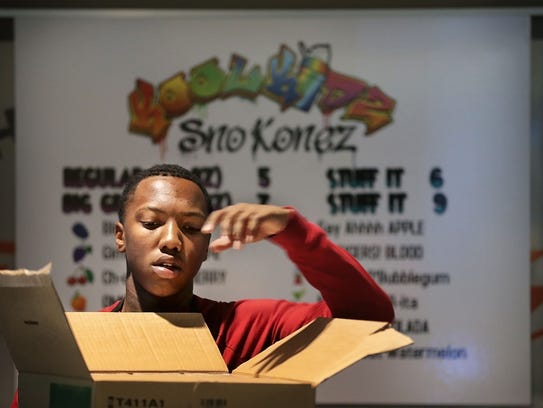 Jaden Wheeler helps set up the Kool Kidz Sno Konez