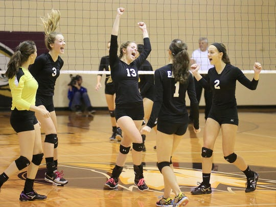PCA players cheer after scoring a point Thursday against