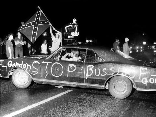 In 1975: Some demonstrators parked their cars across Dixie Highway in Valley Station, snarling traffic so badly that it had to be rerouted by police.