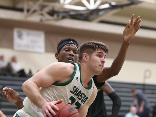 Shasta College's Hunter Johnson takes the ball around Feather River's Moli Mojus during the Knights' 84-71 win on Feb. 7. The Shasta men lost Friday in the CCC Athletic Association Northern California regional playoffs. The men were in the playoffs for the first time since the 2009-10 season after capturing the outright the Golden Valley Conference this year.