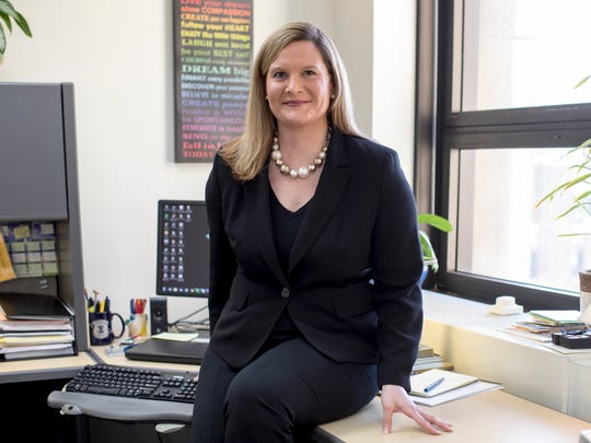 Michigan Assistant Attorney General Angie Povilaitis sits in her Detroit office, Tuesday, Feb. 13, 2018.