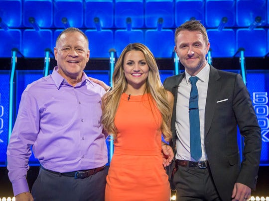 Kirk Spangler and his daughter Brooke Spangler pictured with Chris Hardwick, host of NBC's The Wall. The Spanglers won $1.4 million on an episode of the game show.