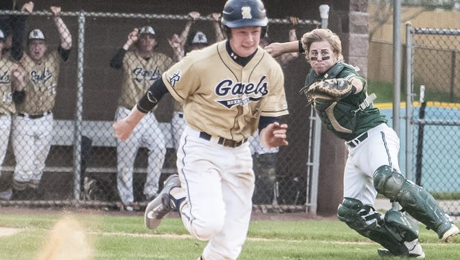 Roxbury's Tucker Voelbel  tries to beat out a bunt, but is thrown out by Delbarton catcher Frank Colantuono in a game last season. Delbarton beat Roxbury, 12-2, on Wednesday.