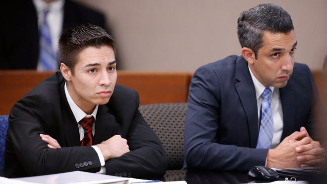 Alberto Mendiola, left, sits with one of his attorneys as a witness testifies recently at his trial.