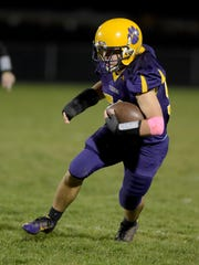 Hagerstown's Jake Combs runs after intercepting a Knightstown ball during a football sectional game Friday, Oct. 28, 2016 in Hagerstown.