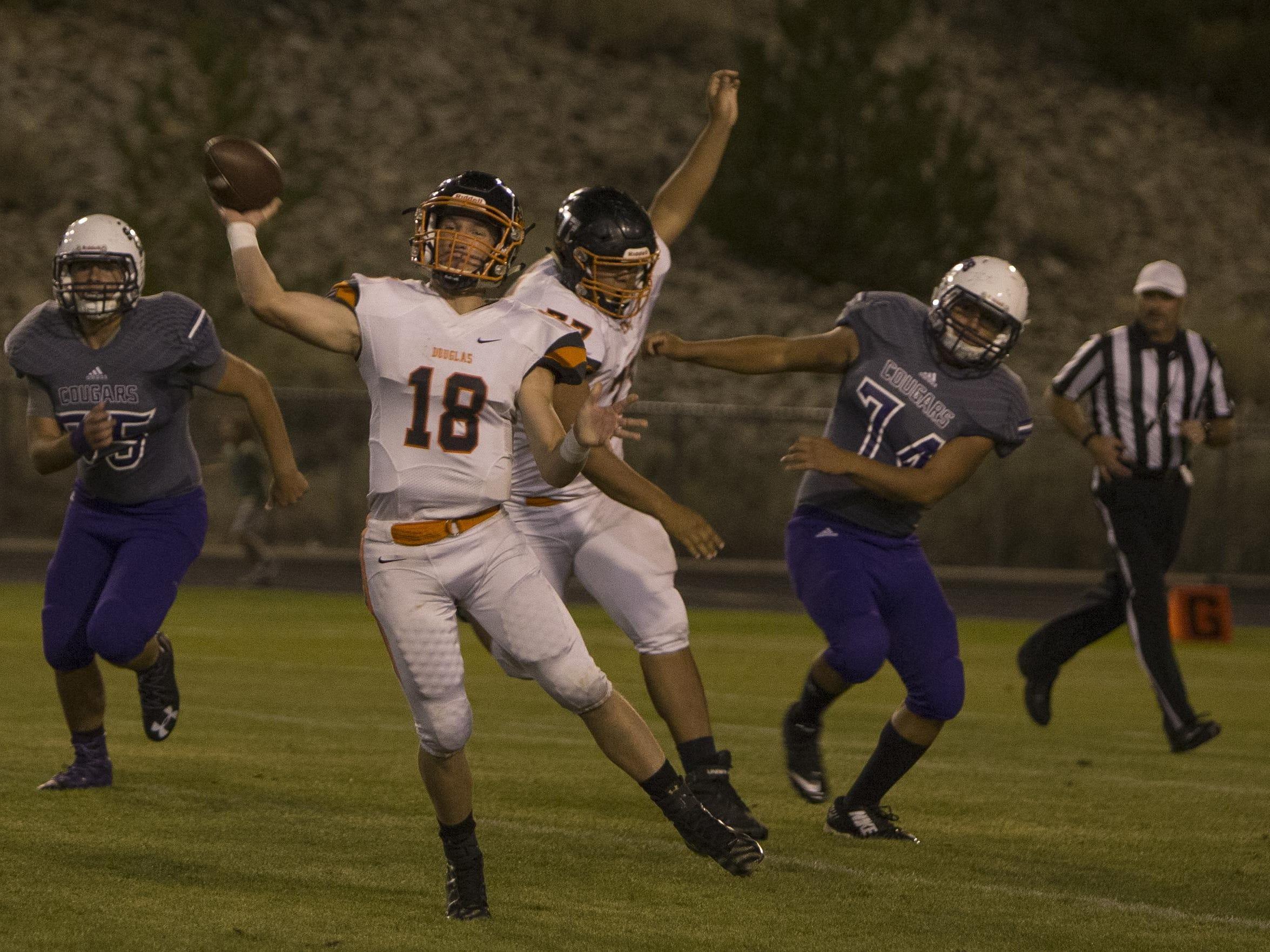 Douglas quarterback Hunter Hickey throws against Spanish Springs on Friday.