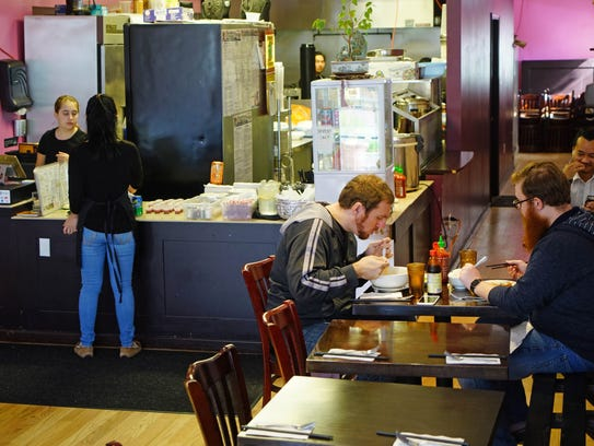 Patron dines at Southeast Kitchen in Forty Acres where
