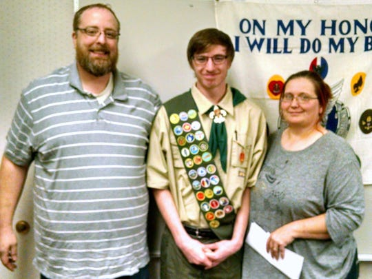 Jared Sullivan, with parents Kevin and Stacey Sullivan, recently attained Eagle Scout status.