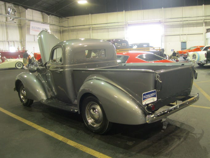 A restored 1937 Studebaker J-5 Coupe Express, featuring