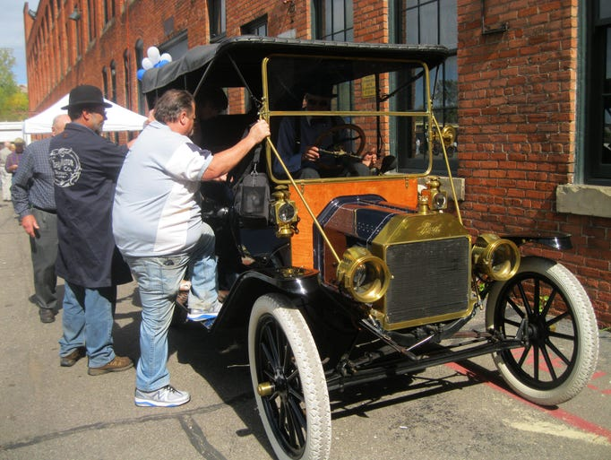 Model T 107th birthday party visitors climb into Barry