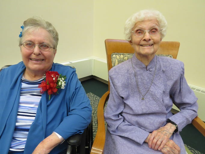 Sisters Clare Haman, left, and Rachel Doerfler celebrated