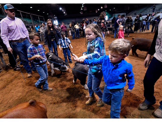 Six-year-old Micah Maberry leads her brother Kelton,
