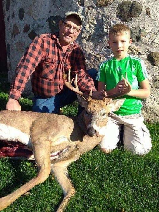 636439319972257882-Father-son-deer.jpg