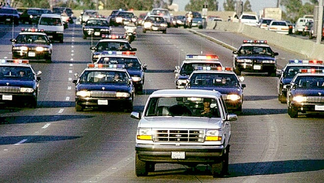 A white Ford Bronco, driven by Al Cowlings carrying O.J. Simpson, is trailed by Los Angeles police cars on June 17, 1996.