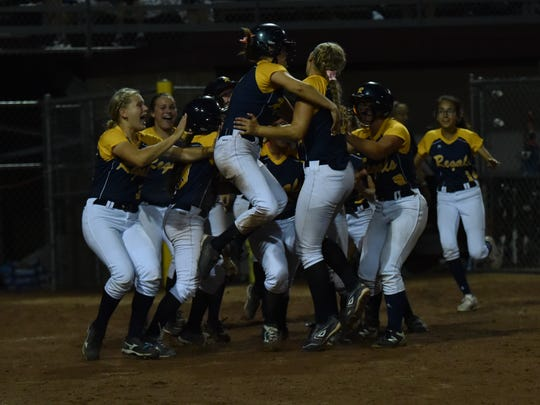 Iowa City Regina celebrates after beating Eddyville for the Class 2A softball state championship on Friday, July 21, 2017.