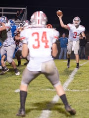 Grant Loy passes the ball to Cody Roberts during the Buckeye Central at Wynford game on Friday night. Wynford was winning at halftime, 21-0.