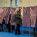 A voter leaves the booth during the New Hampshire primary on Feb. 9.
