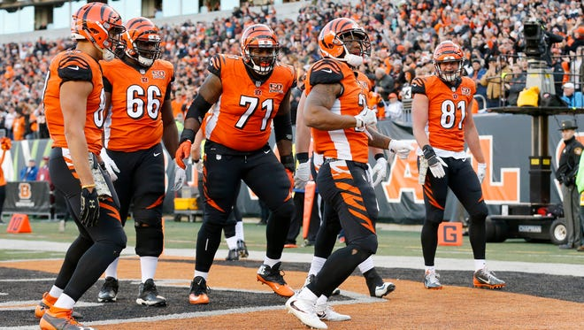 Cincinnati Bengals running back Joe Mixon (28) leads the offense in a dance as they celebrate Mixon's touchdown in the fourth quarter of the NFL Week 12 game between the Cincinnati Bengals and the Cleveland Browns at Paul Brown Stadium in downtown Cincinnati on Sunday, Nov. 26, 2017. The Bengals improved to 5-6 with a 30-16 win over the Browns.