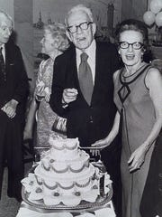 Sen. George Aiken and Lola Aiken sample a birthday cake while celebrating their fifth wedding anniversary and the senator's 80th birthday in 1972.