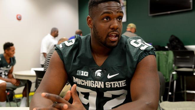 MSU fifth-year senior defensive tackle Joel Heath talks to reporters Monday during media day at Spartan Stadium in East Lansing.