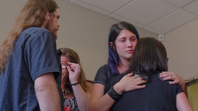 Victoria King, center, is comforted by friends and family after court was adjourned in the murder trial of Thomas McClellan on Thursday, July 20, 2017. McClellan has confessed to killing King's daughter Luna Younger in November 2016.