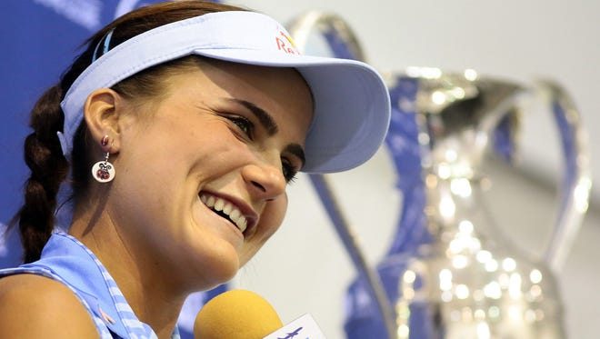 The trophy rests on a podium in the background as defending champion Lexi Thompson talks about the week ahead at the ANA Inspiration on Tuesday, March 31, 2015 during a press conference at the tournament grounds. Thompson won the 2014 tournament, which was known then as the Kraft Nabisco Championship, by three shots over Michelle Wie.