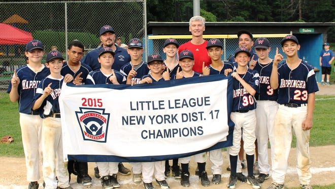 The Wappingers Little League players pose with the pennant after beating LaGrange for the District 17 title Tuesday.