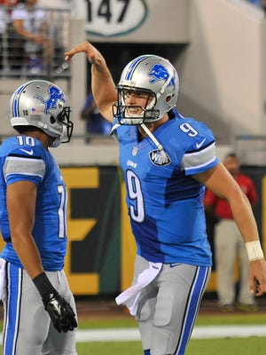 Lions quarterback Matthew Stafford celebrates his touchdown pass to Golden Tate in the second quarter in Friday's win over the Jaguars.