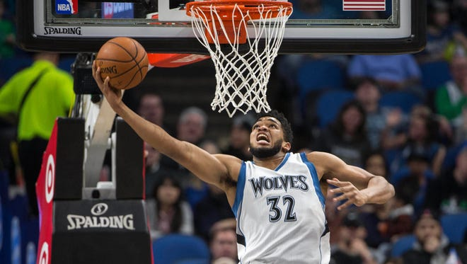 Minnesota Timberwolves center Karl-Anthony Towns (32) dunks the ball in the first half against the New Orleans Pelicans at Target Center.