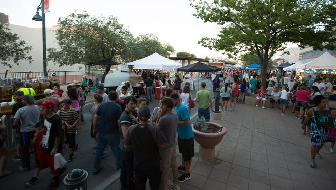 People gather to Downtown Main Street on Wednesday July 13, 2016 for the Las Cruces evening Farmer's Market.