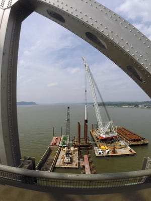 Piles are driven into the Hudson River near the center span of the Tappan Zee Bridge July 8, 2014.