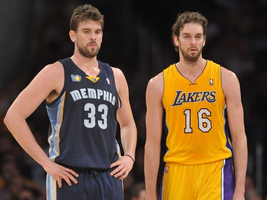 Marc Gasol and Pau Gasol during a game at the Staples