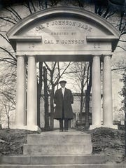 Cal Johnson stands in the archway of Cal Johnson Park. Photo courtesy of Beck Cultural Exchange Center.