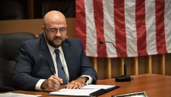 Mayor Mohamed Khairullah signs an executive order upholding the equal protection clause of the U.S. Constitution and reiterating the borough's anti-discrimination policy in the wake of President Donald Trump's executive order.