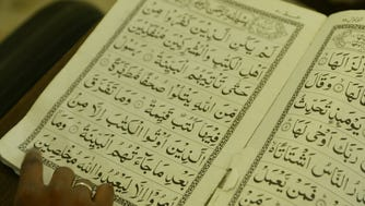 In this file photo, Muslim children read from the Koran.