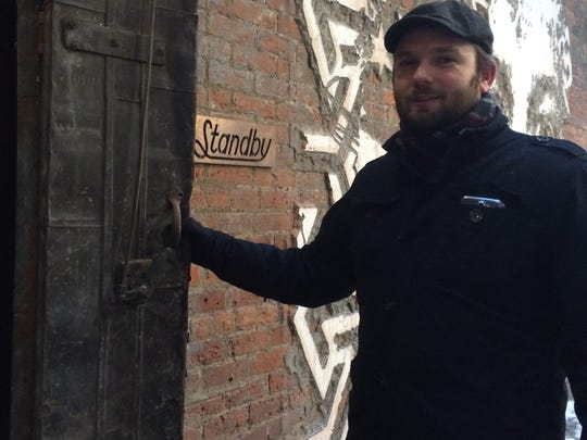 Mark Kurlyandchik, the new restaurant critic at the Detroit Free Press, outside Standby restaurant and bar in the Belt Alley in Detroit.