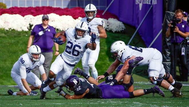Penn State Nittany Lions running back Saquon Barkley (26) is defended by Northwestern Wildcats linebacker Paddy Fisher (42) during the first half at Ryan Field.