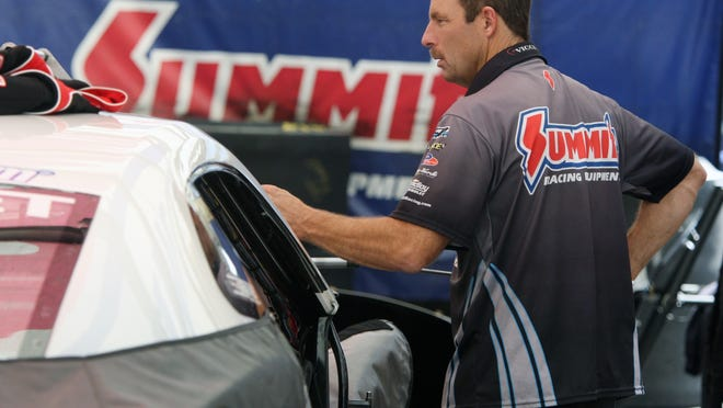 Pro Stock driver Greg Anderson gets ready for the start of racing in his pit area on Friday.