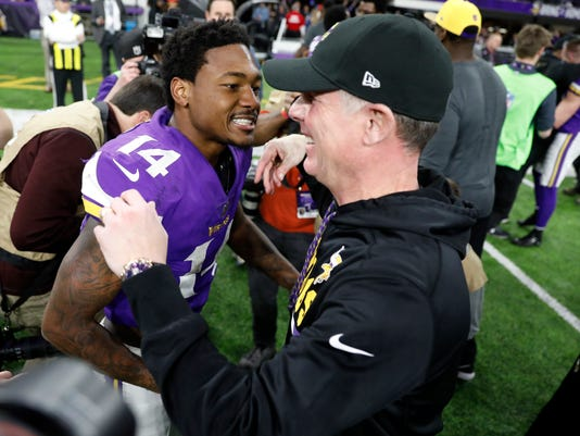 Minnesota Vikings wide receiver Stefon Diggs (14) celebrates with offensive coordinator Pat Shurmur following a 29-24 win over the New Orleans Saints in an NFL divisional football playoff game in Minneapolis, Sunday, Jan. 14, 2018. The Vikings defeated the Saints 29-24. (AP Photo/Charlie Neibergall)
