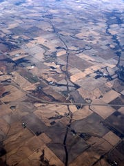 A line of overturned earth where the Dakota Access Pipeline was buried is visible northeast of Des Moines. This photo, taken in 2106 from a commercial flight, shows the pipeline route crossing U.S. Highway 65 near Farrar.