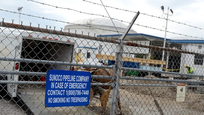 A St. Clair Township woman was facing a $2,800 bill for calling 911 several times in 2014 to report odors she believed were coming from a Sunoco Logistics tank farm.
