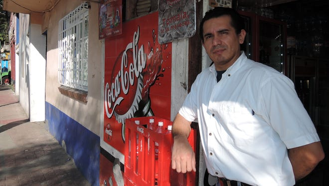 Rodolfo Villanueva, 37, and his family run a mom-and-pop store near the Mexican president's residence. The business depends on selling soda for much of its business so Villanueva believes a proposed tax on sugary drinks will hurt sales.