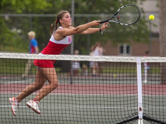 CVU's Sara Erickson, partnered with Kendall Blanck, goes after a shot against South Burlington's Jasmina Jusufagic and Helen Bujold during the girls Division 1 state high school tennis championships in Shelburne on Thursday, June 2, 2016.