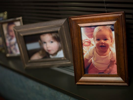 Photographs of Chuck Kelly's grandchildren line the