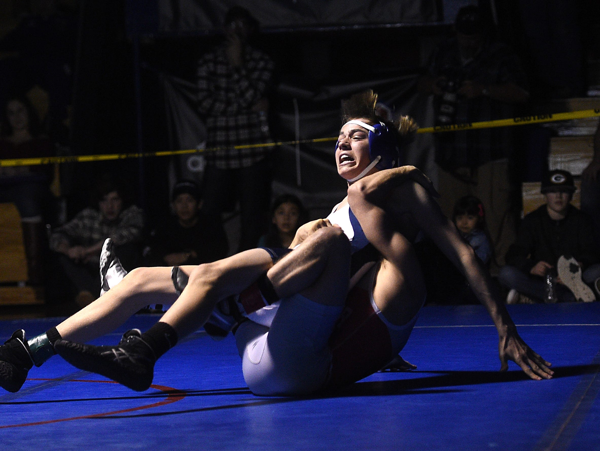 Wooster's Ian Timmins, bottom, defeats Reno's Frankie Giovanetti to win the 126-pound division during the 4A Northern Region Wrestling championships at Reno High School on Saturday