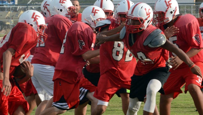 Falcons sophomore defensive end Brandon Rainey (88) penetrates the line of scrimmage looking to get a stop during pass-rush drills at Wednesday's practice. Loving will host Texico in tonight's District 4-3A opener.