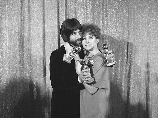 In this Jan. 29, 1977 file photo, Jon Peters and Barbra