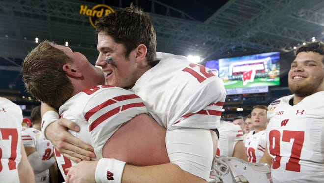 Wisconsin offensive lineman Michael Deiter lifts quarterback Alex Hornibrook after the Orange Bowl victory.