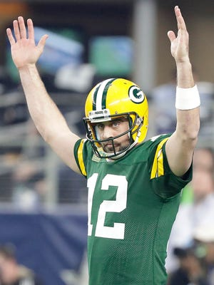 Green Bay Packers quarterback Aaron Rodgers (12) celebrates after a touchdown during the second quarter against the Dallas Cowboys in the NFC Divisional playoff game at AT&T Stadium.