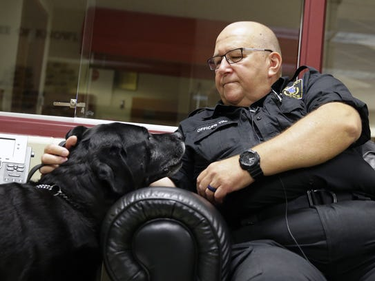 Pulaski police officer James Tinlin and his partner,